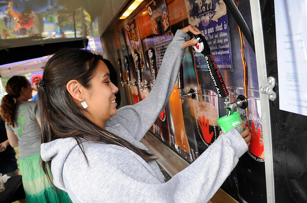 """Christina Santos pours a beer for a customer while working with the Lefthand Brewing Co. during the NedFest music festival on Saturday, Aug. 27, in Nederland. For more photos and video of the event go to  <a href=""""http://www.dailycamera.com"""">http://www.dailycamera.com</a><br /> Jeremy Papasso/ Camera"""