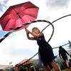 "Ella Mueller, 7, of Nederland, hoola-hoops in the rain during the NedFest music festival on Saturday, Aug. 27, in Nederland. For more photos and video of the event go to  <a href=""http://www.dailycamera.com"">http://www.dailycamera.com</a><br /> Jeremy Papasso/ Camera"