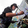 "Keith ""Scramble"" Campbell, of Arvada, paints to the beat of the music during the NedFest music festival on Saturday, Aug. 27, in Nederland. For more photos and video of the event go to  <a href=""http://www.dailycamera.com"">http://www.dailycamera.com</a><br /> Jeremy Papasso/ Camera"