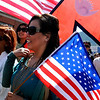 """Darpan Gauchan is framed with the bright colors of the Nepalese and U.S. flags during the parade.<br /> The Nepal New Year of B.S. 2067 was celebrated in Boulder on Sunday with a parade around downtown by area residents.<br /> For more photos, go to  <a href=""""http://www.dailycamera.com"""">http://www.dailycamera.com</a>.<br /> Cliff Grassmick / April 18, 2010"""