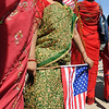 """Sarina Shrestha, 6, holds a US flag during a photo shoot before the parade.<br /> The Nepal New Year of B.S. 2067 was celebrated in Boulder on Sunday with a parade around downtown by area residents.<br /> For more photos, go to  <a href=""""http://www.dailycamera.com"""">http://www.dailycamera.com</a>.<br /> Cliff Grassmick / April 18, 2010"""