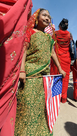 "Sarina Shrestha, 6, holds a US flag during a photo shoot before the parade.<br /> The Nepal New Year of B.S. 2067 was celebrated in Boulder on Sunday with a parade around downtown by area residents.<br /> For more photos, go to  <a href=""http://www.dailycamera.com"">http://www.dailycamera.com</a>.<br /> Cliff Grassmick / April 18, 2010"