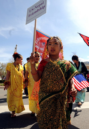 "Sarina Shrestha, 6, marches across Canyon Blvd with about 150 people celebrating Nepal Day.<br /> The Nepal New Year of B.S. 2067 was celebrated in Boulder on Sunday with a parade around downtown by area residents.<br /> For more photos, go to  <a href=""http://www.dailycamera.com"">http://www.dailycamera.com</a>.<br /> Cliff Grassmick / April 18, 2010"
