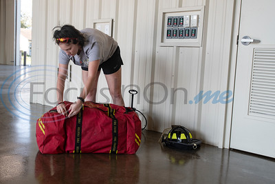 Volunteer firefighter Mckensi Roberts unpacks her gear after returning to new Arp Fire Station No. 1 from a structure fire on Tuesday, Oct. 6, 2020. The new station is serviced by fire crews from Smith County Emergency Services District 2 and Arp Volunteer Fire Department. Beginning on October 4, 2020, the station began housing 24-hour staff. The new facility replaces the former facility built in 1979. New amenities include overnight accommodations, showers, a day room and kitchen, a gym, increased storage and a large training room.