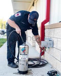 Firefighter Jarren Chaney refills a fire extinguisher at the new Arp Fire Station No. 1 after returning from a structure fire on Tuesday, Oct. 6, 2020. The new station is serviced by fire crews from Smith County Emergency Services District 2 and Arp Volunteer Fire Department. Beginning on October 4, 2020, the station began housing 24-hour staff. The new facility replaces the former facility built in 1979. New amenities include overnight accommodations, showers, a day room and kitchen, a gym, increased storage and a large training room.