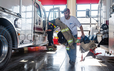 Fire crew members Lieutenant Jared Jones, left, and fire fighter Stephen Sarica, center, unload their gear from two firetrucks after returning to new Arp Fire Station No. 1 from a structure fire on Tuesday, Oct. 6, 2020. The new station is serviced by fire crews from Smith County Emergency Services District 2 and Arp Volunteer Fire Department. Beginning on October 4, 2020, the station began housing 24-hour staff. The new facility replaces the former facility built in 1979. New amenities include overnight accommodations, showers, a day room and kitchen, a gym, increased storage and a large training room.