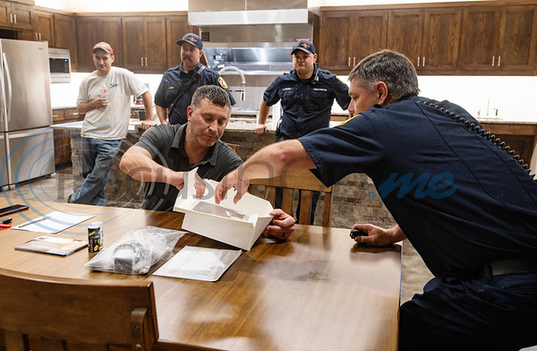 Fire crew members gather in the kitchen of the new Arp Fire Station No. 1 after returning from a structure fire on Tuesday, Oct. 6, 2020. The new station is serviced by fire crews from Smith County Emergency Services District 2 and Arp Volunteer Fire Department. Beginning on October 4, 2020, the station began housing 24-hour staff. The new facility replaces the former facility built in 1979. New amenities include overnight accommodations, showers, a day room and kitchen, a gym, increased storage and a large training room.