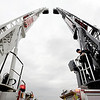 "Dave Martinez, right, operates the ladder of the new fire truck during a demonstration on Wednesday.<br /> The City of Boulder has a new state of the art fire truck and will sell one of the old ones after the transfer of equipment.<br /> For a video and more photos, go to  <a href=""http://www.dailycamera.com"">http://www.dailycamera.com</a>.<br /> Cliff Grassmick  / October 24, 2012"