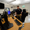 KRISTOPHER RADDER - BRATTLEBORO REFORMER<br /> Brattleboro Det. Ryan Washburn shows the inside of the dispatch center in the new Brattleboro Police Department on Friday, Sept. 15, 2017.