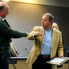 COUNCIL<br /> Tim Plass, left, gets a fist bump from George Karakehian after the swearing-in ceremony of the new Boulder city council on Tuesday.<br /> <br /> <br /> PHOTO BY MARTY CAIVANO<br /> Nov. 15, 2011