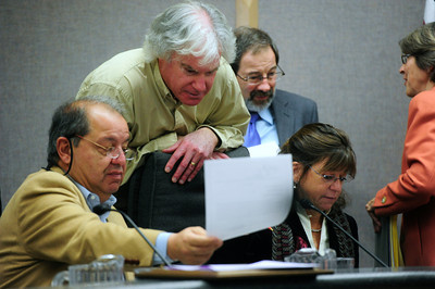 COUNCIL Left to right, George Karakehian, newly-elected mayor Matt Applebaum, and newly-elected deputy mayor Lisa Morzel convene for a moment after the swearing-in ceremony of the new Boulder city council on Tuesday. In the background are Ken Wilson and Suzy Ageton.   PHOTO BY MARTY CAIVANO Nov. 15, 2011