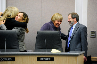 COUNCIL At left, departing city council member Crystal Gray gets a hug from KC Becker, while Ken Wilson, right, jokes with outgoing mayor, Susan Osborne, after the swearing-in ceremony of the new Boulder city council on Tuesday.   PHOTO BY MARTY CAIVANO Nov. 15, 2011