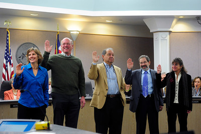 COUNCIL Left to right, Suzanne Jones, Tim Plass, George Karakehian, Ken Wilson and Lisa Morzel take their oath during the swearing-in ceremony of the new Boulder city council on Tuesday.   PHOTO BY MARTY CAIVANO Nov. 15, 2011