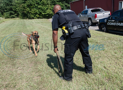 Smith County Constable Pct. 5 deputy Alvin Gordon plays with Flash outside of his office in Lindale on Thursday, Aug. 20, 2020. In October after training, Gordon and Flash will become official K-9 officers.