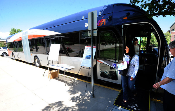 "Sonia Soglia walks out of the new rapid transit bus on display in Boulder made by North American Bus Industries (NABI).<br /> For a video more photos  of the bus, go to  <a href=""http://www.dailycamera.com"">http://www.dailycamera.com</a>.<br /> Cliff Grassmick / June 6, 2012"