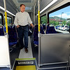 "Peter Maguire walks through the bus  of the  new rapid transit bus on  made by North American Bus Industries (NABI) on display in Boulder on Wednesday. <br /> For a video of the bus, go to  <a href=""http://www.dailycamera.com"">http://www.dailycamera.com</a>.<br /> Cliff Grassmick / June 6, 2012"