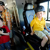"Mason McKay, right, 6, tries out the drivers seat as his dad, Matt and brother, Ryland, walk through the new rapid transit bus made by North American Bus Industries (NABI) on display in Boulder on Wednesday.<br />  For a video and more photos of the bus, go to  <a href=""http://www.dailycamera.com"">http://www.dailycamera.com</a>.<br /> Cliff Grassmick / June 6, 2012"