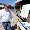 "Peter Maguire looks at the bus routes of the  new rapid transit bus on  made by North American Bus Industries (NABI) on display in Boulder on Wednesday.<br />  For a video of the bus, go to  <a href=""http://www.dailycamera.com"">http://www.dailycamera.com</a>.<br /> Cliff Grassmick / June 6, 2012"