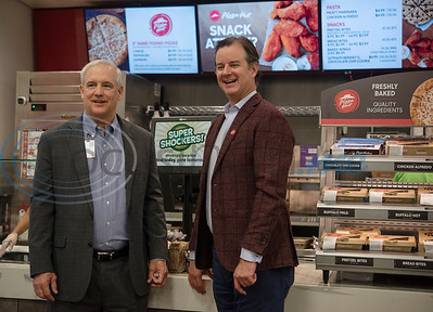Brad Brookshire, Chairman/CEO of Brookshire Grocery Co., and Pizza Hut CEO Artie Starrs stand in front of the new Pizza Hut kiosk inside of Super 1 Foods, 3828 Troup Hwy. in Tyler, Texas on Monday, Nov. 25, 2019. Pizza Hut's first grocery store kiosks are open daily from 11 a.m. to 7 p.m. and offer a menu that includes personal pizzas, pastas, hot wings, ultimate Hershey's chocolate chip cookies, and parmesan and pretzel bites. The second Pizza Hut kiosk location in Tyler is at Brookshires, 2734 E. Fifth Street.  (Sarah A. Miller/Tyler Morning Telegraph)