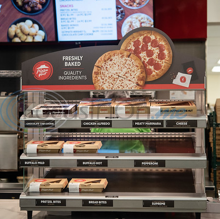 Free samples of pizzas and other products are given away at the new Pizza Hut kiosk inside of Super 1 Foods, 3828 Troup Hwy. in Tyler, Texas opens on Monday, Nov. 25, 2019. Pizza Hut's first grocery store kiosks are open daily from 11 a.m. to 7 p.m. and offer a menu that includes personal pizzas, pastas, hot wings, ultimate Hershey's chocolate chip cookies, and parmesan and pretzel bites. The second Pizza Hut kiosk location in Tyler is at Brookshires, 2734 E. Fifth Street.  (Sarah A. Miller/Tyler Morning Telegraph)