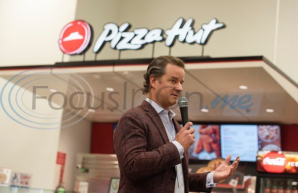 Pizza Hut CEO Artie Starrs speaks at the grand opening of the Pizza Hut kiosk inside of Super 1 Foods, 3828 Troup Hwy. in Tyler, Texas on Monday, Nov. 25, 2019. Pizza Hut's first grocery store kiosks are open daily from 11 a.m. to 7 p.m. and offer a menu that includes personal pizzas, pastas, hot wings, ultimate Hershey's chocolate chip cookies, and parmesan and pretzel bites. The second Pizza Hut kiosk location in Tyler is at Brookshires, 2734 E. Fifth Street.  (Sarah A. Miller/Tyler Morning Telegraph)