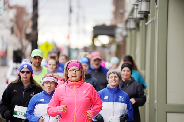 BEN GARVER — THE BERKSHIRE EAGLE<br /> Runners crown the sidewalk on North Street competing in Pittsfield's first 5k race of the year.  The race ends with a buffet and a beer at the Hotel on North and is staged by the Berkshire Running Center, Tuesday, January 1, 2019. The race had 150 finishers.