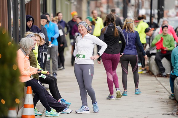 BEN GARVER — THE BERKSHIRE EAGLE<br /> Runners relax outside the Hotel on North after Pittsfield's first 5k race of the year.  The race ends with a buffet and a beer at the Hotel on North and is staged by the Berkshire Running Center, Tuesday, January 1, 2019. The race had 150 finishers.