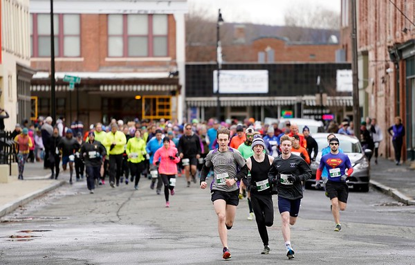 BEN GARVER — THE BERKSHIRE EAGLE<br /> Runners start Pittsfield's first 5k race of the year on Union Street.  The race ends with a buffet and a beer at the Hotel on North and is staged by the Berkshire Running Center.