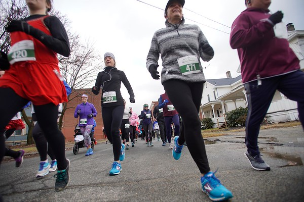 BEN GARVER — THE BERKSHIRE EAGLE<br /> Runners start Pittsfield's first 5k race of the year on Union Street.  The race ends with a buffet and a beer at the Hotel on North and is staged by the Berkshire Running Center, Tuesday, January 1, 2019. The race had 150 finishers.
