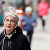 BEN GARVER — THE BERKSHIRE EAGLE<br /> Marka O'Connell  of Canaan, NY, Finishes the New Year's Day 5k race in Pittsfield with a New Years hat.  The race was in Downtown Pittsfield,Tuesday, January 1, 2019.