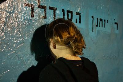 A young woman prays on the grave of Rabbi Yochanan Hasandlar on the Jewish holiday of Lag BaOmer. Meron, Israel. 22/05/2011.