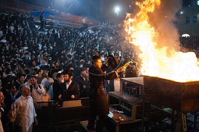 Hundreds of thousands celebrate the Jewish holiday of Lag BaOmer at the gravesite of Rabbi Shimon Bar Yochai feeding bonfires with bottles of oil. Meron, Israel. 22/05/2011.