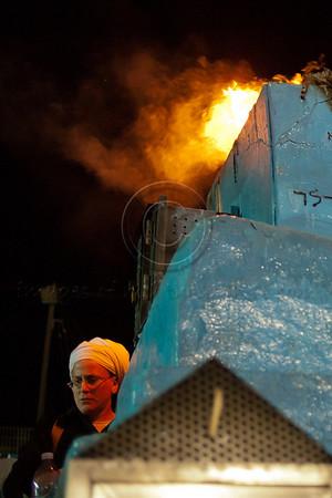 A woman near a bonfire on the grave of Rabbi Yochanan Hasandlar on the Jewish holiday of Lag BaOmer. Meron, Israel. 22/05/2011.