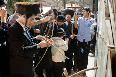 """Young archers aim and shoot arrows at a hand written sign indicating their own """"natural evil inclinations"""" to overcome urges of wrong doing at the gravesite of Rabbi Shimon Bar Yochai. Meron, Israel. 22/05/2011."""