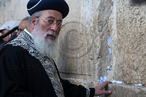 """Hundreds gathered today at the Wailing Wall for a mass prayer for rain, following a day of fast called upon by Chief Rabbis of Israel. Jerusalem, Israel. 29/11/2010.  Services at the Kotel were lead by Rabbi Shlomo Moshe Amar, HaRishon LeTzion, Chief Rabbi of Spharadic Jews and President of The Great Rabbinical Court and silver horns were sounded. Yesterday, Rabbi Amar sent a plea to the worldwide Jewish community to join the fast and prayer, writing """"We must gather and shout out to the Creator of the universe to have mercy and compassion on his people Israel, and His Mercies are abundant.""""<br /> <br /> According to statistical data provided by the Israel Meteorological Service to date there has only been 9mm of rainfall on a nationwide average, which is only about 9% of the rainfall last year at this time and only 2% of the multi-year seasonal average."""
