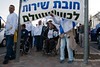 A three-day military-style march with stretchers, protesting draft <br /> evasion mainly by the Haredi ultra-orthodox community, has reached its final leg. <br /> Jerusalem, Israel. 20/01/2011.   Originating from the Tel-Hashomer main IDF draft center <br /> demonstrators marched over twenty kilometers per day for the past two days. <br /> Organised by a coalition of over fifty political and social organisations <br /> from the full spectrum of Israeli society, this diversified group protested against widespread draft evasion, especially by the ultra-orthodox Haredi community. Leading the march were handicapped veterans who sacrificed their well-being for the country. Stretchers were carried inline with one of the IDF's most important values - never leave a wounded man in the field. <br /> <br /> This afternoon they symbolically assembled at the Mount Hertzel Military Cemetery and <br /> marched to Kikar Paris Square, opposite the Prime Minister's residence in <br /> Jerusalem where a rally was held attended by several hundreds of <br /> demonstrators. <br /> <br /> Speakers at the rally included Shachar Botzer, Asistant Head of the Students Union in Israel, who volunteered for military duty despite his handicap, Parliament Member Avi Dichter, former warrior in elite IDF MATKAL unit, awarded a military citation, former Head of General Security Services (Shin-Bet) and former Minister of Internal Security, Parliament Member Zvulun Orlev, awarded an IDF Medal of Distinguished Service and former minister in numerous ministries, Jerusalem Mayor Nir Barkat, retired paratroopers Major, former Parliament Member Dr. Tzvia Greenfield and Head of Opposition, Parliament Member, Tzipi Livni, former Mossad agent and former minister in numerous ministries including Minister of Foreign Affairs.