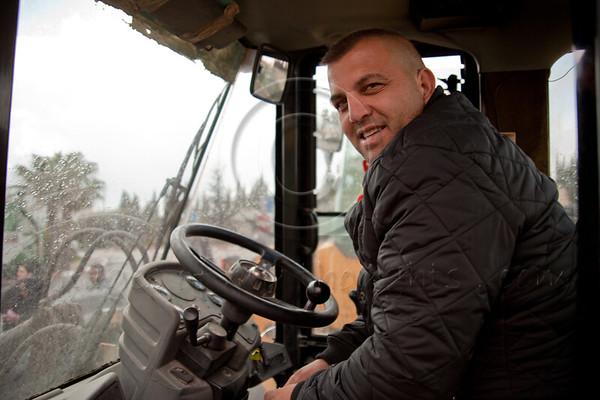 Jerusalem Mayor Nir Barkat inspects municipal preparedness for forecasted snow tonight at Municipal Maintenance Center in Givat Shaul. Bulldozer operator, Tzvika, may well be busy tonight. Jerusalem, Israel. 09/03/2011.