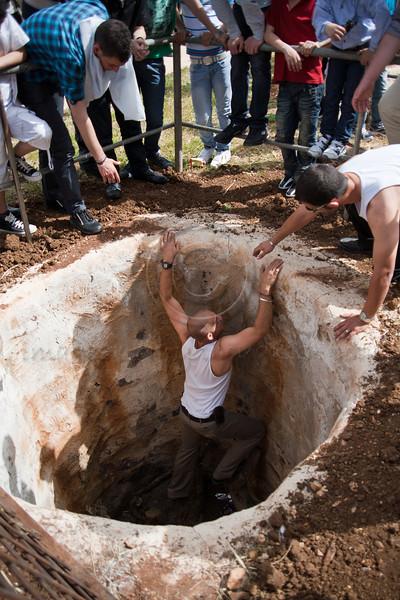 Samaritan men prepare pits as ovens for roasting sacrificial lambs on Passover. Mount Gerizim, Israel. 17/04/2011.