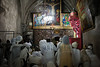 Ethiopian Christians worship and await the Holy Fire ceremony in the Ethiopian Orthodox Church at the Holy Sepulcher Church in Jerusalem.