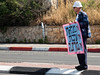 "Father Noam Shalit carries a sign reading ""No Leadership. No Mutual Responsibility. No State."" as a handful of supporters protest near the Prime Minister's Office as the government is convened for its weekly meeting. Jerusalem, Israel. 01/05/2011."