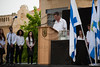 High school principal Dr. Gilad Amir speaks to audience in a ceremony marking Holocaust Martyrs' and Heroes' Remembrance Day with Holocaust survivors, city council members, municipal employees and high school students.
