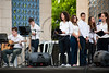 Students sing on stage in a ceremony marking Holocaust Martyrs' and Heroes' Remembrance Day with Holocaust survivors, city council members, municipal employees and high school students.