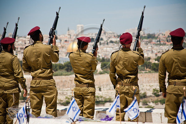 IDF Paratroopers inspect their weapons for live rounds following a Memorial Day Ceremony on Mount of Olives overlooking the city.