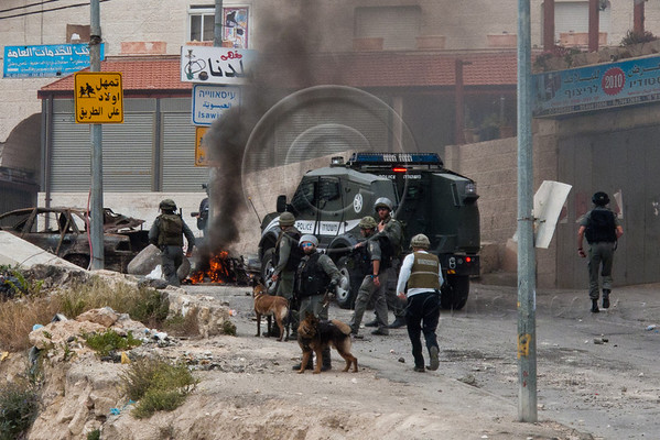 Jerusalem Police prepare to disperse a few dozen Palestinian youths rioting in Isawiyah on Yom El-Naqba. Jerusalem, Israel. 15/05/2011.                                                     Palestinian youths hurl stones and Molotov Cocktails at policemen, burn tires and block the road into the village of Isawiyah in Jerusalem on Yom El-Naqba. Jerusalem Police dispersed the rioting youth with tear gas. One policeman was lightly injured. One arrest was made.