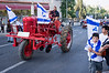 Man drives a 1945 Farmall MD in a colorful parade on the eve of the 44th anniversary of the reunification of Jerusalem under Israeli sovereignty. Jerusalem, Israel. 30 May 2011.