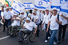 Handicapped veterans take part in a colorful parade on the eve of the 44th anniversary of the reunification of Jerusalem under Israeli sovereignty. Jerusalem, Israel. 30 May 2011.