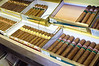 Cigars for sale on display in tobacco shop on World No Tobacco Day. Jerusalem, Israel. 31 May 2011.<br /> <br /> In 1989 the World Health Organization (WHO) called for the observance of World No Tobacco Day (WNTD) annually on May 31. Across the globe, WNTD encourages a 24-hour period of abstinence from all form of tobacco consumption. It intends to bring to people's awareness the devastating health, social, environmental and economic consequences of tobacco use and exposure to tobacco smoke.<br /> <br /> Since 2003, the WHO Framework Convention on Tobacco Control (FCTC) has been adopted by 172 countries and the European Union. According to a WHO press release, among other measures, the parties are obliged over time to: protect people from exposure to tobacco smoke, ban tobacco advertising and sales to minors, put large health warnings on packages of tobacco, ban or limit additives to tobacco products, increase tobacco taxes and create a national coordinating mechanism for tobacco control.<br /> <br /> WHO advocate tobacco use is one of the biggest contributors to the epidemic of noncommunicable diseases - such as heart attack, stroke, cancer and emphysema - which accounts for 63% of all deaths, nearly 80% of which occur in low- and middle-income countries. Up to half of all tobacco users will eventually die of a tobacco-related disease.<br /> <br /> Many governments use WNTD as the start date for implementing new smoking bans and tobacco control efforts. Just a few days ago the Israeli government agreed on new legislation further limiting smokers in public areas by prohibiting smoking in outdoors locations including bus and train depots and outdoor restaurants and cafes.<br /> <br /> But, not one of the photographed smokers in this story had heard anything about World No Tobacco Day.