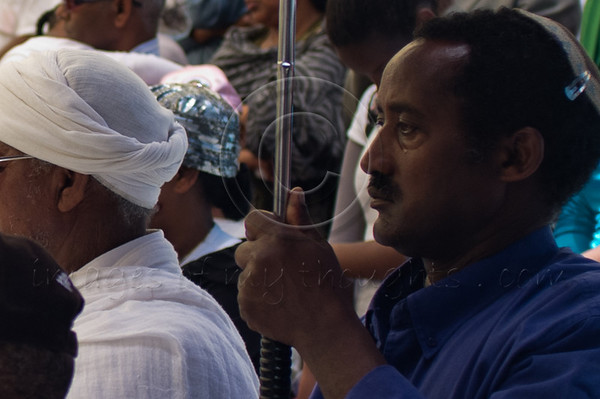 """Pain and sorrow at a memorial service for 4,000 Ethiopian Jews held at Mount Hertzel, symbolically coinciding with Jerusalem Reunification Day. Jerusalem, Israel. 01/06/2011.<br /> <br /> The Ethiopian Jewish community, called Beta-Israel, lived in seclusion for over 1,000 years, only reconnecting to the Jewish world in the late 20th century. According to Ethiopian tradition, their roots go back 3,000 years to the era of King Solomon. Like their brethren in many parts of the world, Ethiopian Jews suffered persecution for their beliefs and refusal to adopt Christianity. In the Middle Ages their lands were confiscated, villages plundered and many murdered. They were nicknamed Falash - intruders, homeless and without property. The Ethiopian Jewish community, living for so long in complete seclusion, were convinced they were the last Jews left on the face of the Earth. They practiced all the religious rituals with which they were familiar including male circumcision on the eight day from birth, Kashrut (Kosher) rules dealing with food, the holiness of the Sabbath and they prayed, three times a day, facing the holy city of Jerusalem, yearning to return.<br /> <br /> In 1975 Israel formally recognized """"Beita Israel"""" as a part of the Jewish nation. In 1977 Israeli PM Menachem Begin instructed the government to bring them home. The Ethiopian government refused to release them and millions of dollars were transferred to the government of Sudan for them to be allowed refugee status in its territory. The rumor spread quickly to villages all over Ethiopia – a route to Jerusalem via Sudan. Thousands left their homes overnight and set out on a long and dangerous journey to Sudan through unbearable desert heat, thirst and hunger, avoiding bandits and the Ethiopian military. They left everything they had behind. They were walking towards fulfillment of a thousands of years old dream – reuniting with Jerusalem.<br /> <br /> Refugee camps in Sudan were of horrible conditions - hunger"""