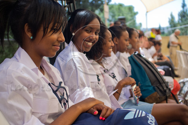 "Students at a memorial service for 4,000 Ethiopian Jews held at Mount Hertzel, symbolically coinciding with Jerusalem Reunification Day. Jerusalem, Israel. 01/06/2011.<br /> <br /> The Ethiopian Jewish community, called Beta-Israel, lived in seclusion for over 1,000 years, only reconnecting to the Jewish world in the late 20th century. According to Ethiopian tradition, their roots go back 3,000 years to the era of King Solomon. Like their brethren in many parts of the world, Ethiopian Jews suffered persecution for their beliefs and refusal to adopt Christianity. In the Middle Ages their lands were confiscated, villages plundered and many murdered. They were nicknamed Falash - intruders, homeless and without property. The Ethiopian Jewish community, living for so long in complete seclusion, were convinced they were the last Jews left on the face of the Earth. They practiced all the religious rituals with which they were familiar including male circumcision on the eight day from birth, Kashrut (Kosher) rules dealing with food, the holiness of the Sabbath and they prayed, three times a day, facing the holy city of Jerusalem, yearning to return.<br /> <br /> In 1975 Israel formally recognized ""Beita Israel"" as a part of the Jewish nation. In 1977 Israeli PM Menachem Begin instructed the government to bring them home. The Ethiopian government refused to release them and millions of dollars were transferred to the government of Sudan for them to be allowed refugee status in its territory. The rumor spread quickly to villages all over Ethiopia – a route to Jerusalem via Sudan. Thousands left their homes overnight and set out on a long and dangerous journey to Sudan through unbearable desert heat, thirst and hunger, avoiding bandits and the Ethiopian military. They left everything they had behind. They were walking towards fulfillment of a thousands of years old dream – reuniting with Jerusalem.<br /> <br /> Refugee camps in Sudan were of horrible conditions - hunger, illness, epidemics and death. Four thousand men, women and children, one fifth of the community perished on their way to fulfilling the dream. <br /> <br /> In1984 Israel activated ""Operation Moshe"". Four thousand Ethiopian Jews were brought to Israel in a lightning fast attempt to save them. Families came apart. Children were quickly loaded on airlifts sometimes without their parents. The operation was abruptly aborted when leaks to the press hit the headlines all over the world. US intervention brought an additional six U.S. Hercules airplanes with refugees to Israel. <br /> <br /> In1991 political changes in Ethiopia caused great worry for the destiny of the remaining Ethiopian Jews. ""Operation Shlomo"" began. Tens of millions of dollars changed hands as bribery and air lifts to Israel began again. In less than 48 hours 14,000 were saved and flown to the Israel.<br /> <br /> The reality of Jerusalem, not literally of gold, a modern city far from purity and holiness was a shock to many. Integration into the Israeli society was not easy for Ethiopian Jews. Culture shock, lack of education, lack of work skills, the undermining of the traditional family structure, all caused alienation and detachment. Separated Ethiopian neighborhoods evolved as a result of government policy mistakes and Ethiopian aspiration to stay together. <br /> <br /> In 2003 a committee of ministers dealing with immigration and absorption decided to erect a monument for the demoralization of the Ethiopian Jews who lost their lives en-route to Jerusalem, on Mount Hertzel. The government decided an official memorial service would be held on Mount Hertzel on the Jewish date of 28th of Iyar, symbolically coinciding with Jerusalem Reunification Day.<br /> <br /> In March 2007 the monument was inaugurated. It was designed by architect Gabriel Kertesz, in cooperation with the Ethiopian community, incorporating monologues written by Ethiopian Jews describing their village life in Ethiopia, their yearning for Jerusalem and the hardships of the journey to Israel.<br /> <br /> As singer Itzik Bessa sang ""We Will Not Forget You"" the sobs in the audience occasionally overcame the singer's voice and President Shimon Peres' soft words offered little comfort to this unique community, in which almost no family was untouched by tragedy."