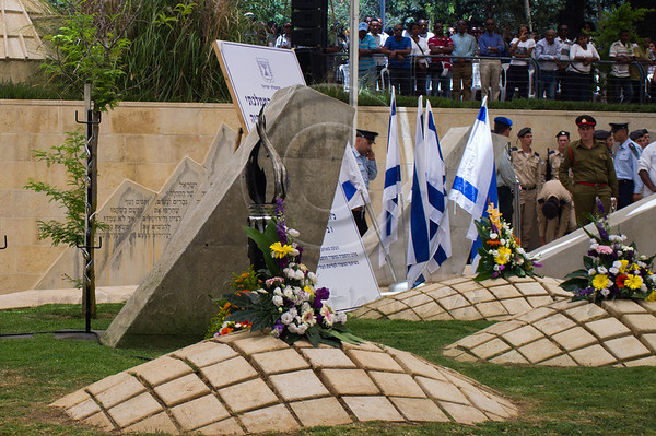 """A memorial service for 4,000 Ethiopian Jews held at Mount Hertzel, symbolically coinciding with Jerusalem Reunification Day. Jerusalem, Israel. 01/06/2011.<br /> <br /> The Ethiopian Jewish community, called Beta-Israel, lived in seclusion for over 1,000 years, only reconnecting to the Jewish world in the late 20th century. According to Ethiopian tradition, their roots go back 3,000 years to the era of King Solomon. Like their brethren in many parts of the world, Ethiopian Jews suffered persecution for their beliefs and refusal to adopt Christianity. In the Middle Ages their lands were confiscated, villages plundered and many murdered. They were nicknamed Falash - intruders, homeless and without property. The Ethiopian Jewish community, living for so long in complete seclusion, were convinced they were the last Jews left on the face of the Earth. They practiced all the religious rituals with which they were familiar including male circumcision on the eight day from birth, Kashrut (Kosher) rules dealing with food, the holiness of the Sabbath and they prayed, three times a day, facing the holy city of Jerusalem, yearning to return.<br /> <br /> In 1975 Israel formally recognized """"Beita Israel"""" as a part of the Jewish nation. In 1977 Israeli PM Menachem Begin instructed the government to bring them home. The Ethiopian government refused to release them and millions of dollars were transferred to the government of Sudan for them to be allowed refugee status in its territory. The rumor spread quickly to villages all over Ethiopia – a route to Jerusalem via Sudan. Thousands left their homes overnight and set out on a long and dangerous journey to Sudan through unbearable desert heat, thirst and hunger, avoiding bandits and the Ethiopian military. They left everything they had behind. They were walking towards fulfillment of a thousands of years old dream – reuniting with Jerusalem.<br /> <br /> Refugee camps in Sudan were of horrible conditions - hunger, illness, epidemic"""
